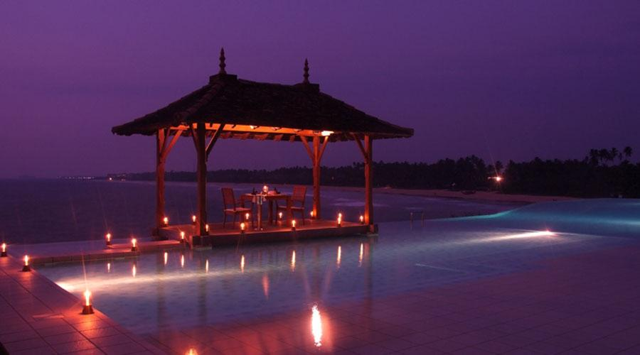 private dining table at the infinity pool by night