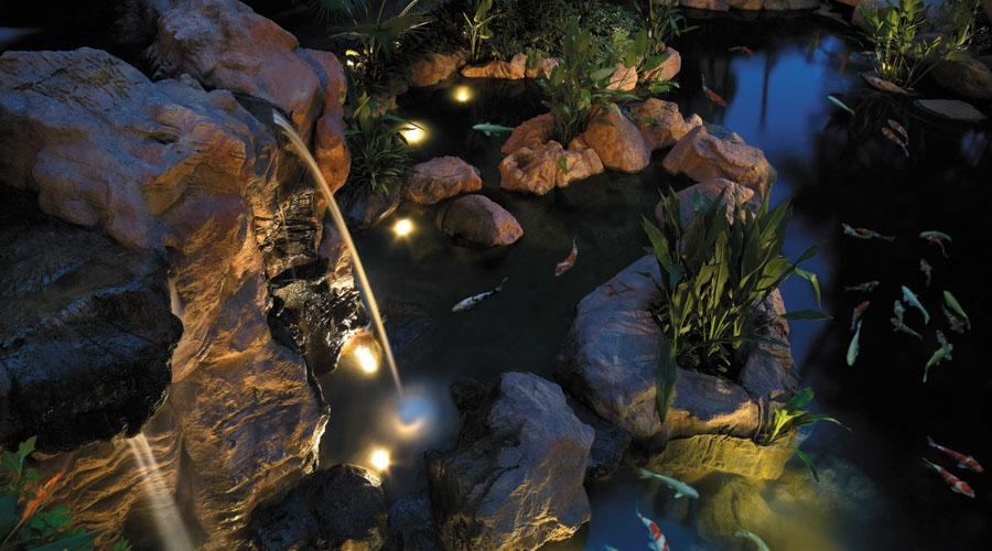 Garden Wing Waterfall and Koi Pond by Night